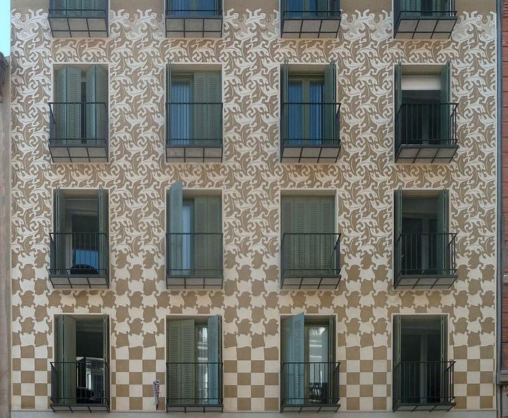 Facade decorated showing an Escher's design from Metamorphosis II.