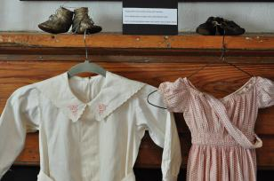 Child's romper and dress and button leather shoes Circa 1910-1920