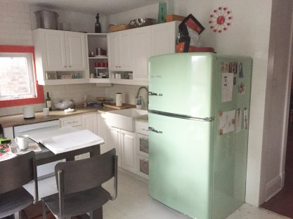 Semi staged old kitchen and we are keeping that fridge and sink