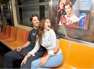 "NEW YORK, NY - JULY 16: ""Mane Man"" C.J. Wilson and model Lisalla Montenegro ride the Head & Shoulders Branded 7 Train during MLB All-Star Week on July 16, 2013 in New York City. (Photo by D Dipasupil/Getty Images for Head & Shoulders) ORG XMIT: 173976805"