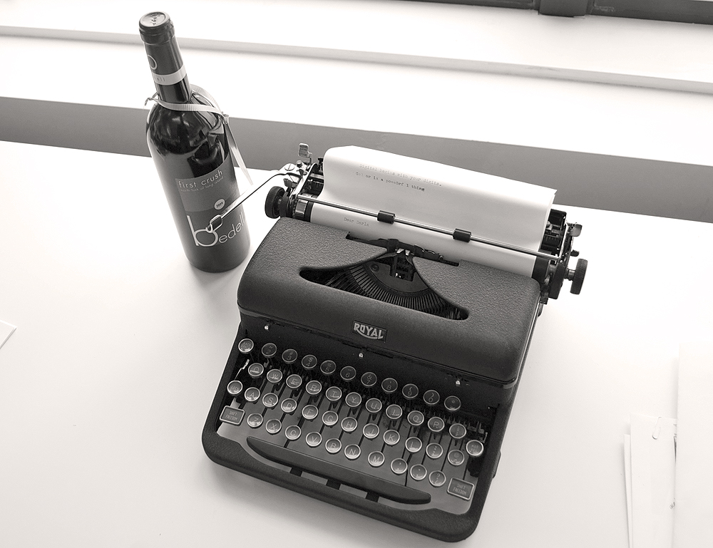Image result for wine and a typewriter
