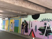 Michelle Miller and Madeleine Tonzi at work on their mural for the 9th Street Underpass
