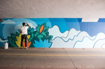 David Polka at work on Moorhead Ave. mural (photo by Lauren Click)