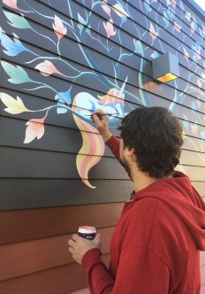 Tony Zellaha painting a mural for Creative Neighborhoods