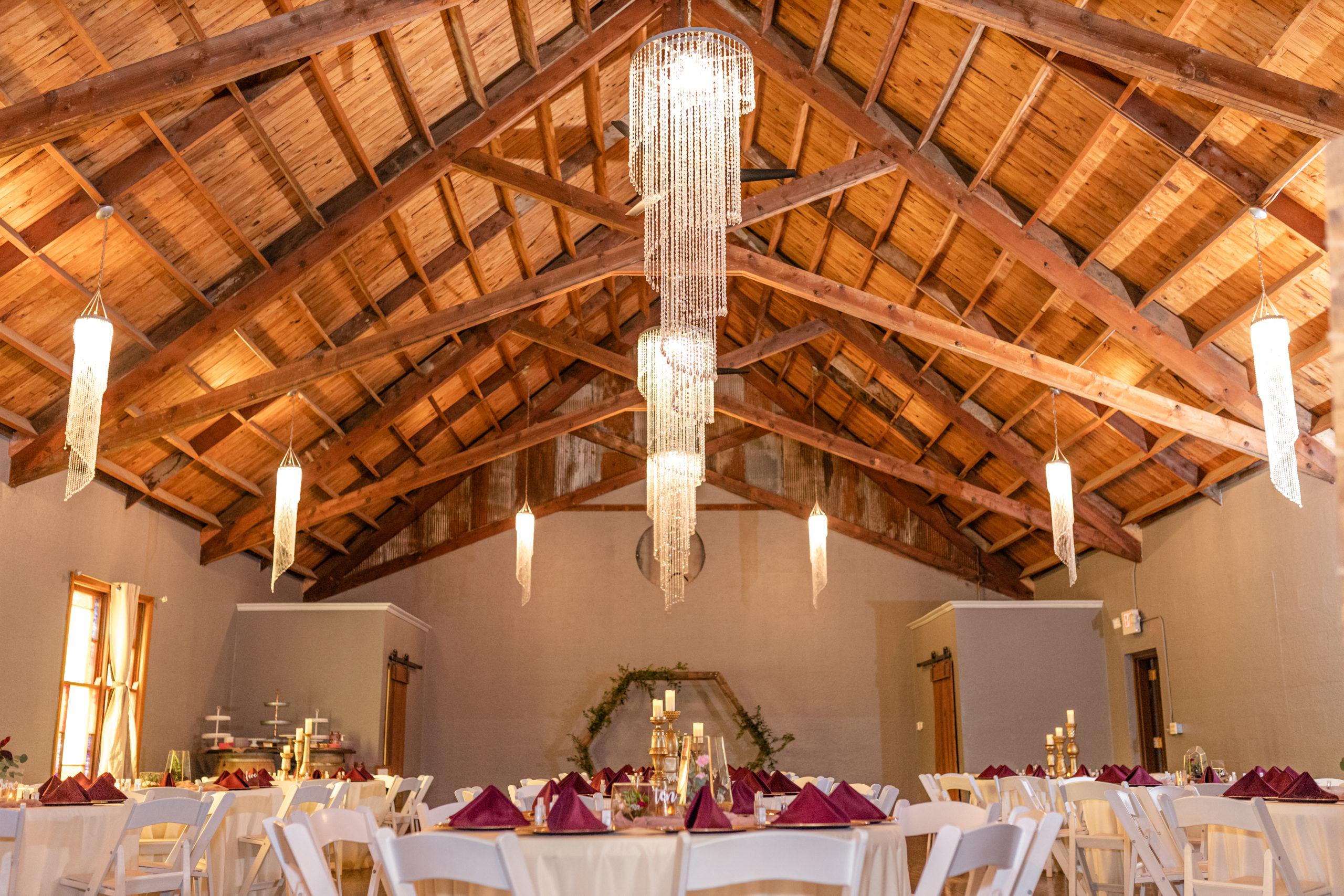 banquet hall, reception hall, rustic, chandeliers, dark purple,
