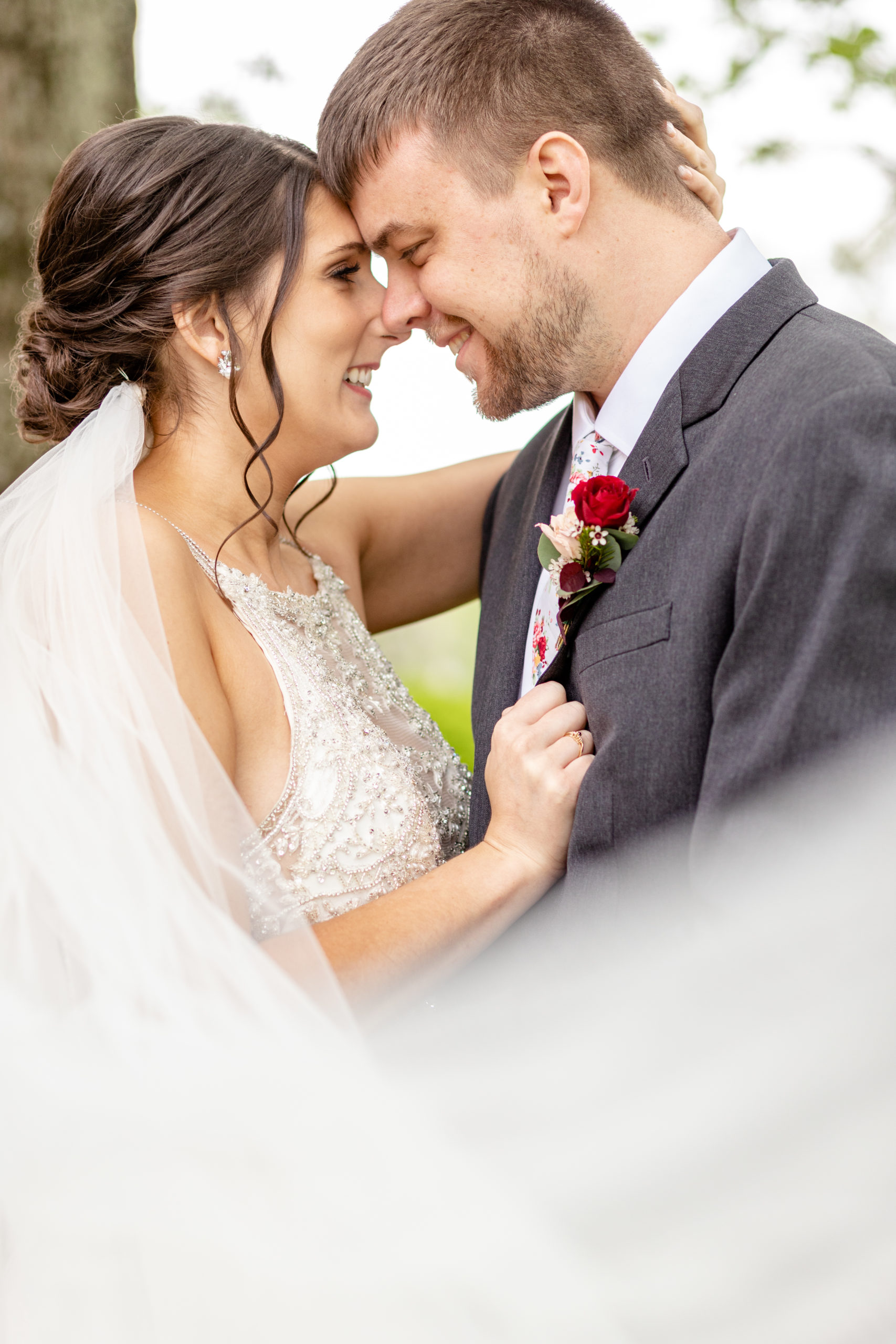 bride and groom, veil, wedding dress, grey suit, red rose boutonniere