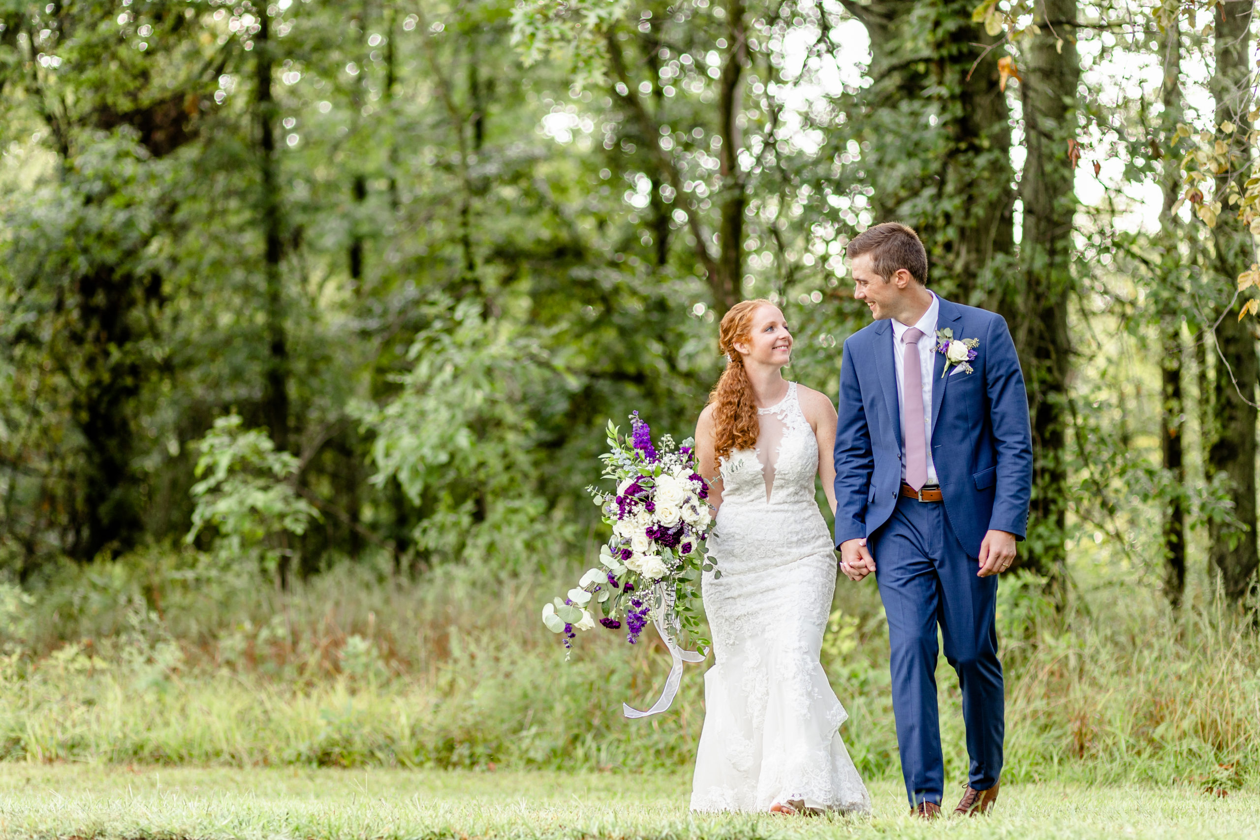 wedding photography, summer romance wedding, purple wedding accents, southern illinois wedding photography, walking bride and groom, woodland romance, woodland wedding, and blue wedding