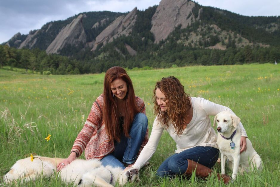 Pet Therapeutic Bodywork specialists Claire and Marcy pet their dogs
