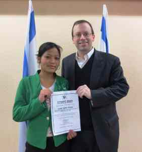 Shavei Israel Chairman Michael Freund with Mirna Singsit - the 2000th Bnei Menashe immigrant.  Photo courtesy of Shavei Israel