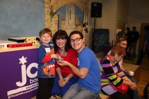 Ezra Margolis makes a donation to the Kids Campaign. With Beth Margolis and Jonathan Lev