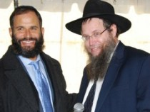 Rabbi Moshe Scheiner congratulates Rabbi Pesach Scheiner on the groundbreaking.