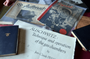"""Displayed are some of the more than 500,000 pieces of the Mazal Holocaust Collection. The large book in the lower center, """"Auschwitz: Technique and operation of the gas chambers,"""" is one of only five in print and two are part of the collection. Photo by Glenn Asakawa/University of Colorado"""