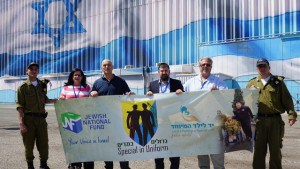 Alan Wolk (second from right) and Aviva Postelnik of the JNF Task Force on Disabilities with Yossi Kahana, the task force's director (third from right), Tiran Attia, director of Special in Uniform and two Special in Uniform soldiers.