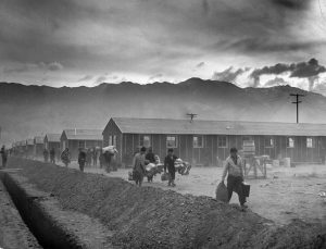The first group of 82 Japanese-Americans arrive at the Manzanar internment camp (or 'War Relocation Center') carrying their belongings in suitcases and bags, Owens Valley, California, March 21, 1942. Manzanar was one of the first ten internment camps opened in the United States, and it's peak population, before it was closed in Novemeber 1945, was over 10,000 people. (Photo by Eliot Elisofon/Time & Life Pictures/Getty Images)