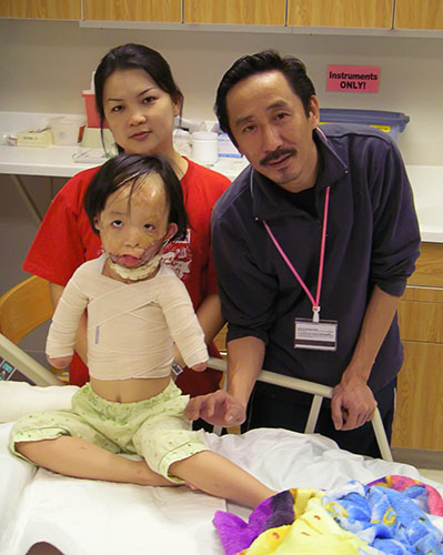 Boun Lod, feeling better, with her mom and dad.
