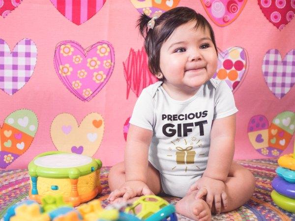 Baby girl in Precious Gift onesie