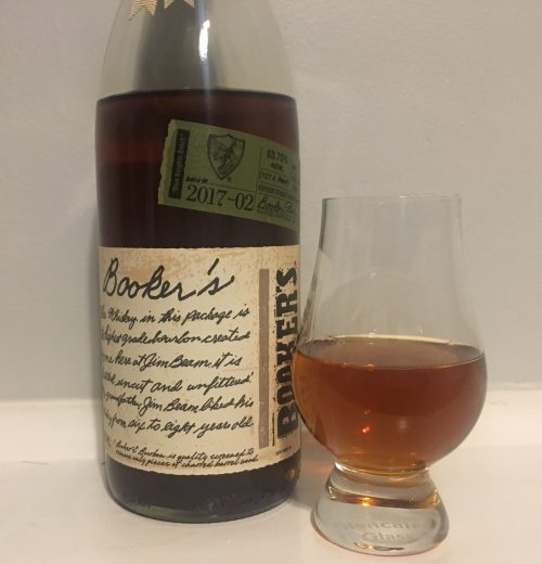 Bottle of Bookers with patially filled glencairn glass