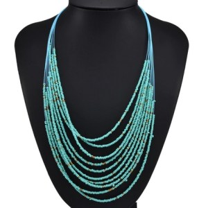Sautoir petites perles turquoises