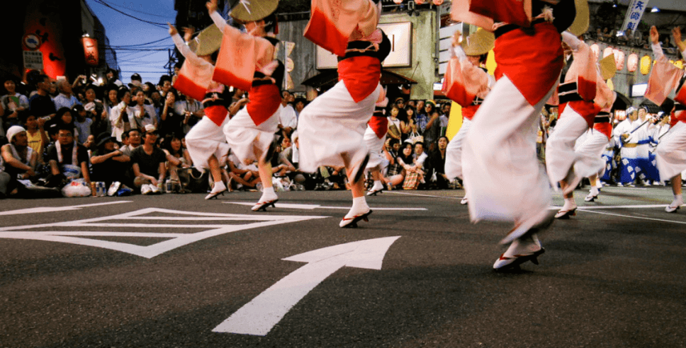 At the Awa Odori festival. Attending a matsuri is one of our top 5 things to do in Japan