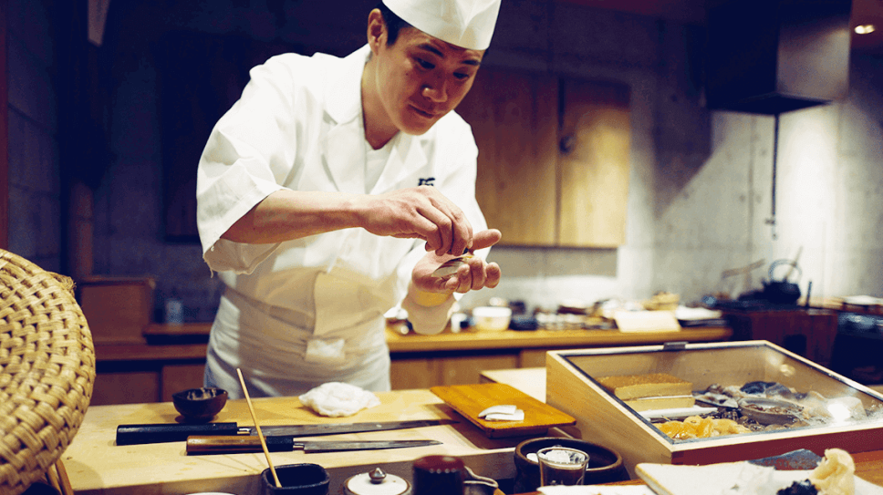 A Japanese chef prepares sushi