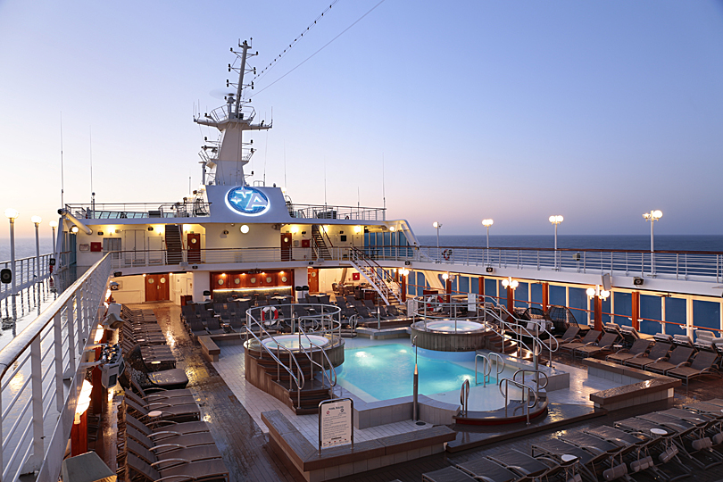 Pool Deck at sunrise on the boutique luxury cruiser, Azamara Journey