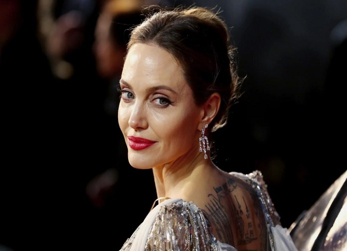 Angelina Jolie says she relates to her 'broken, messed up' character in new film