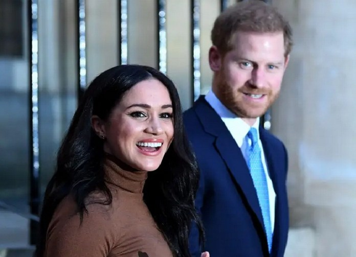 Prince Harry says he woke up to Meghan Markle crying into her pillow over a 'smear campaign' against her