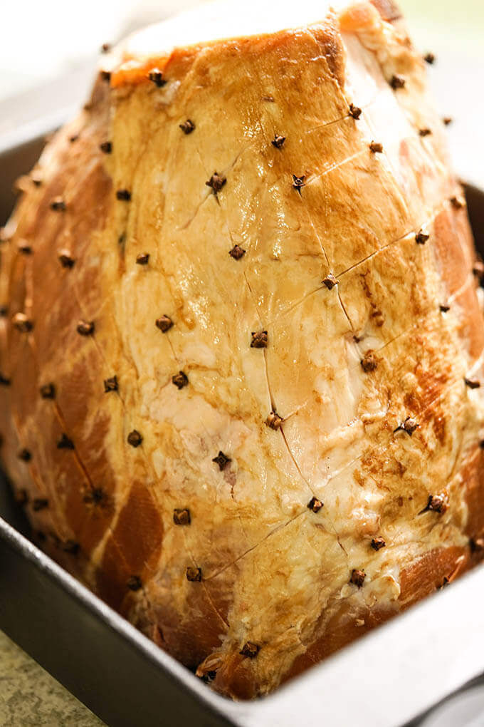 A ham with studded with cloves ready to bake.