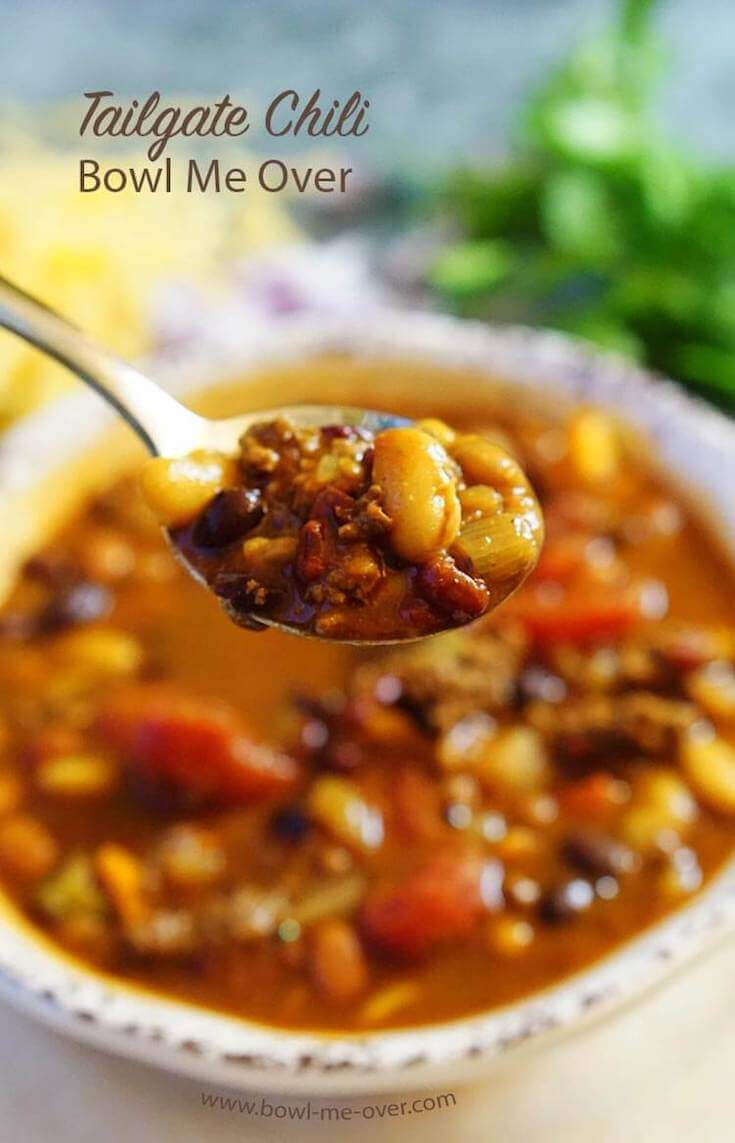 A hearty bowlful of chili with a big spoonful ready to gobble up!