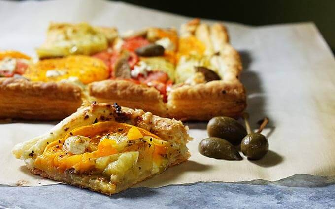 A baked Tomato Tart using Puff Pastry sliced and ready to serve.