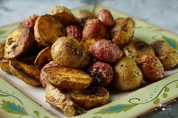 Roasted Radishes Recipe with Potatoes on a green platter.