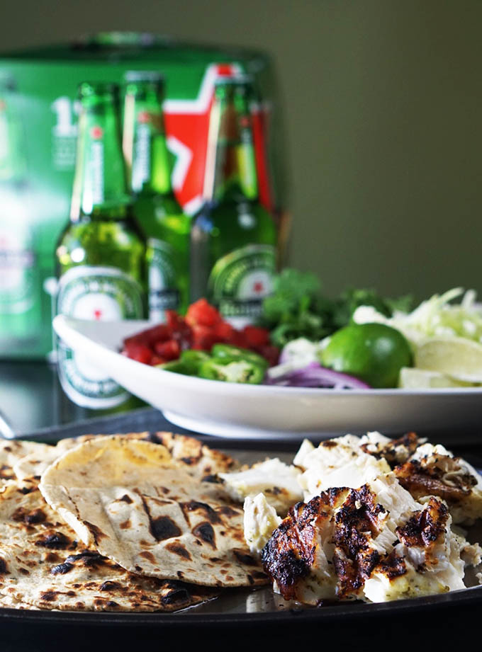 Grilled Baja Fish Tacos served with a crisp, cold Heineken is best with family & friends!