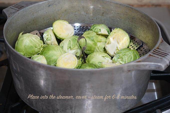 Brussels sprouts In steamer on stovetop.