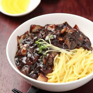 Jjajangmyeon in white bowl.