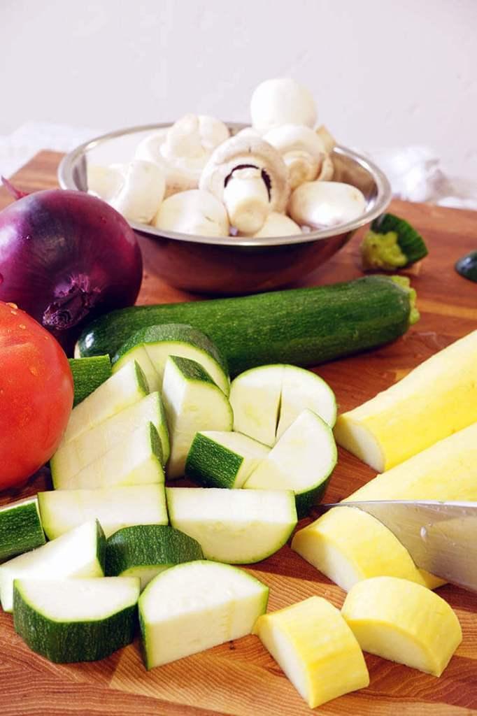Chopped zucchini, yellow squash and mushroom on a platter.
