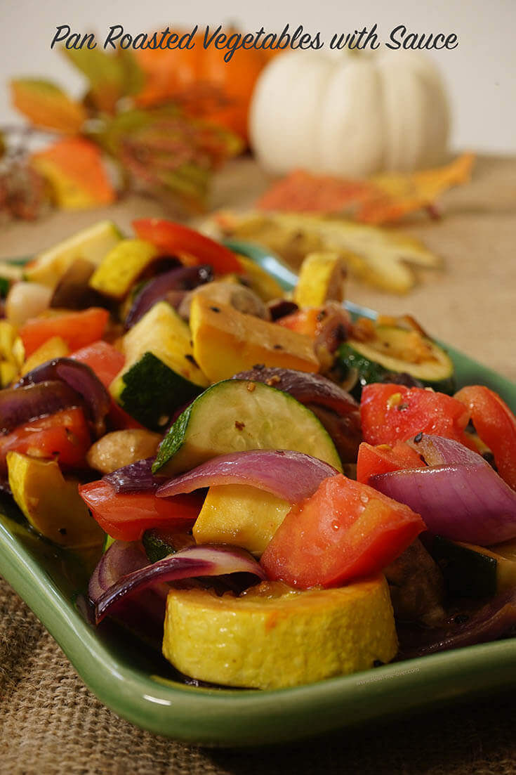 Pan Roasted Vegetables with sauce on green platter.