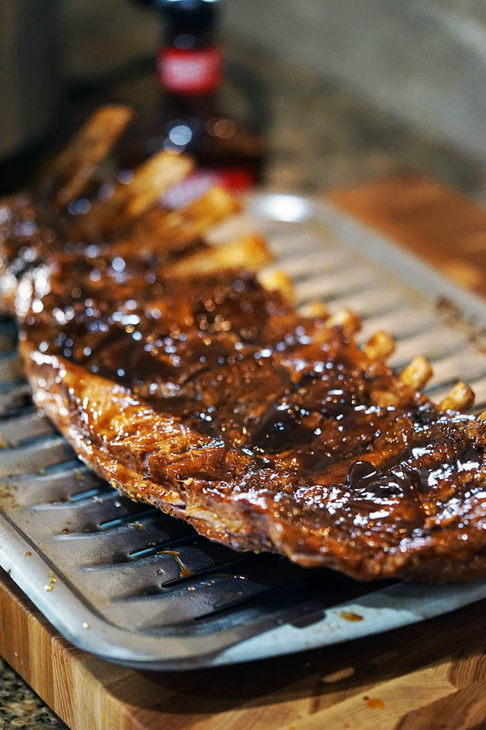 A slab of grilled pork ribs.