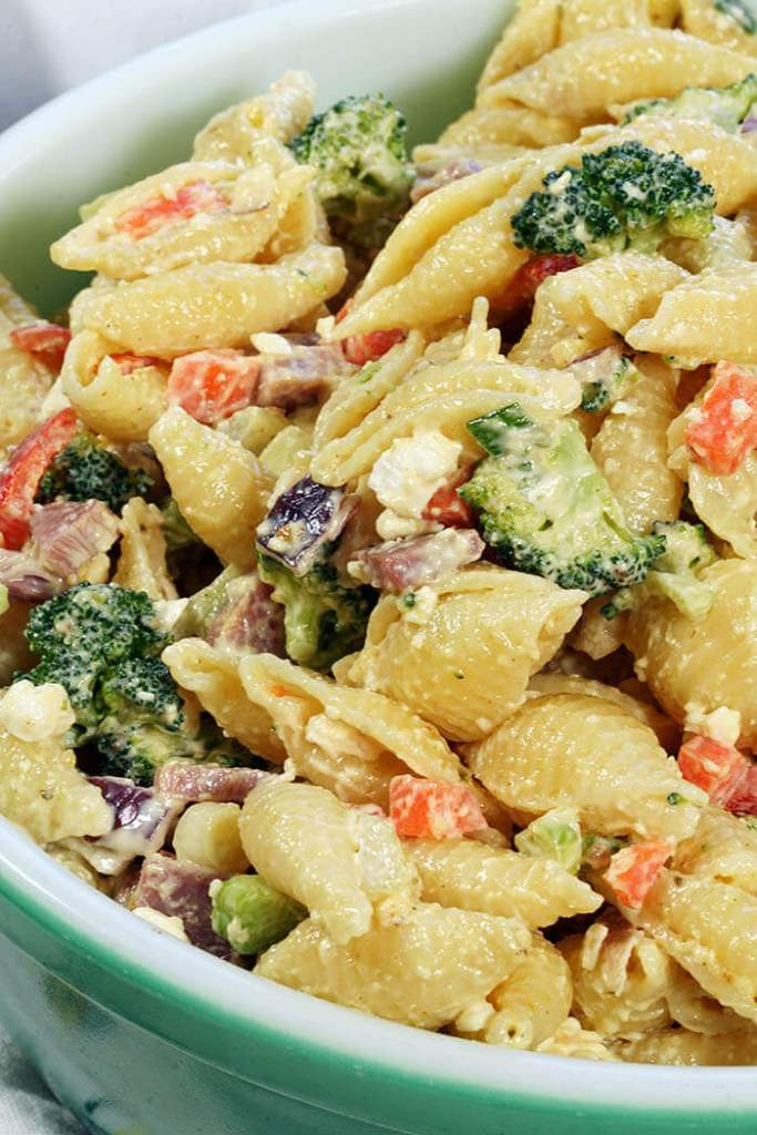 Ham, feta cheese and veggies are packed into Ham Pasta Salad and topped with a creamy mayonnaise dressing.