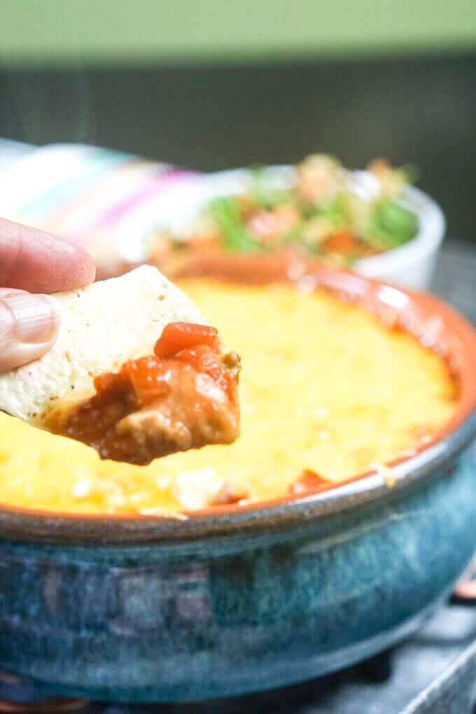 Refried Bean Dip on a tortilla chip.