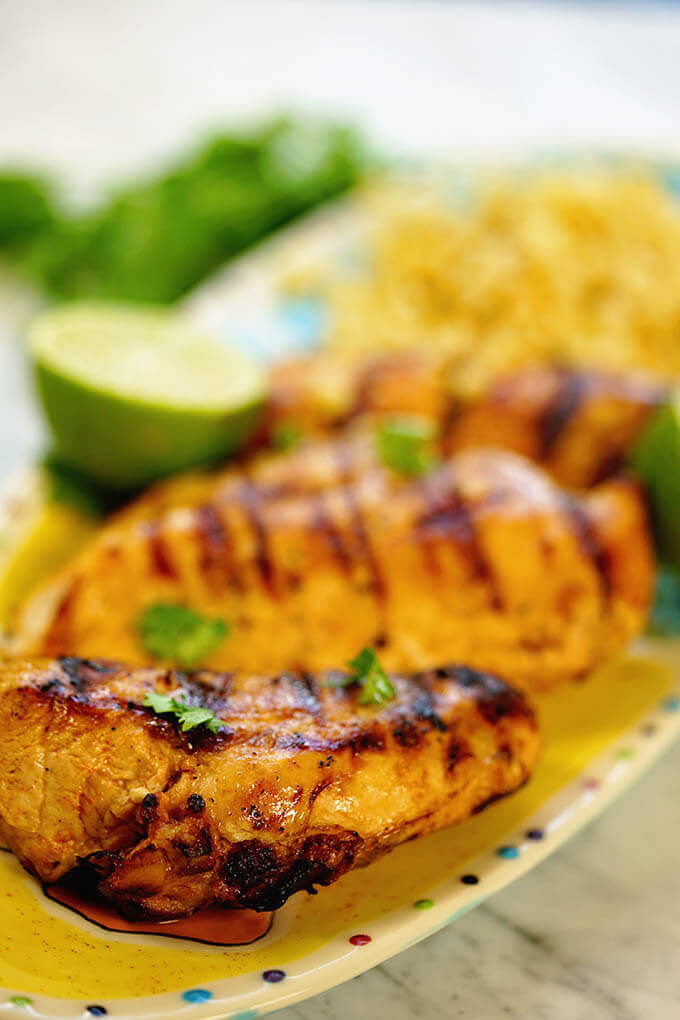 Chili lime chicken marinade - a platter of grilled chicken and corn. Who's hungry?!!!