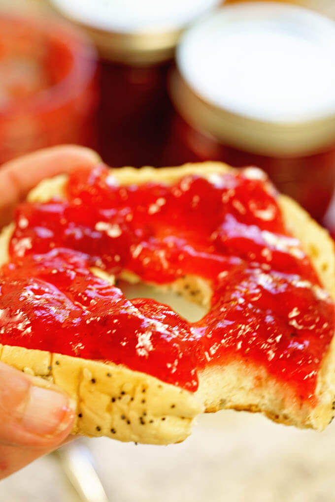 Bagel topped with homemade strawberry jam.