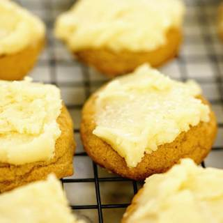 Butterscotch cookies on a cooling rack. They've just been frosted.