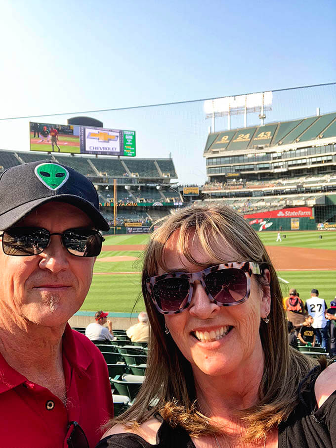A little more about me - A picture of Dan and I at the Oakland A's game enjoying family fun night!