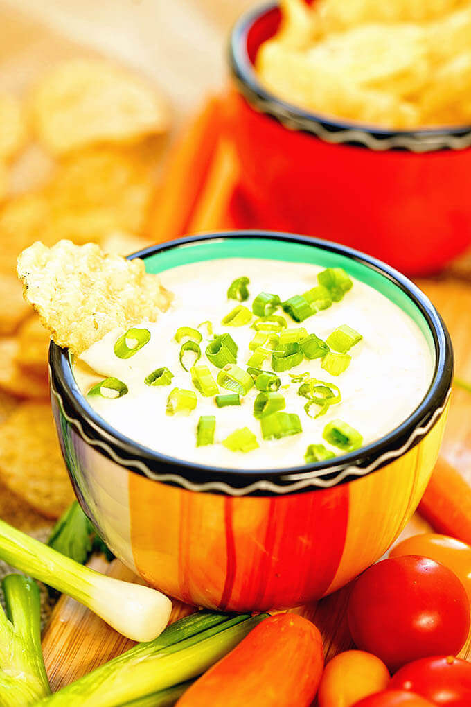 Homemade Onion Dip Recipe in a bright orange bowl surrounded by chips