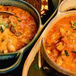 Two bowls of easy lasagna soup recipe garnished with minced parsley.