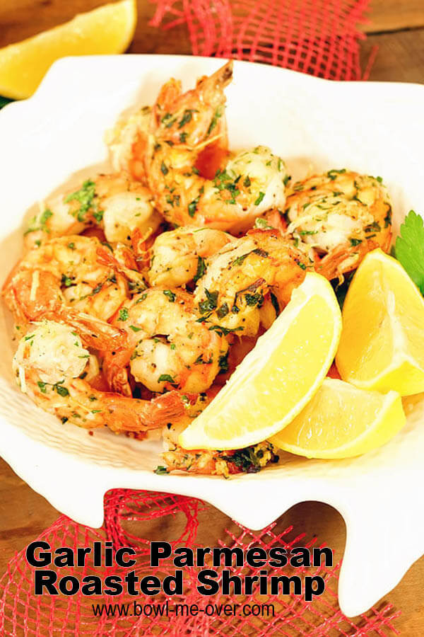 Roasted Air Fryer Shrimp in a white bowl with lemon wedges.