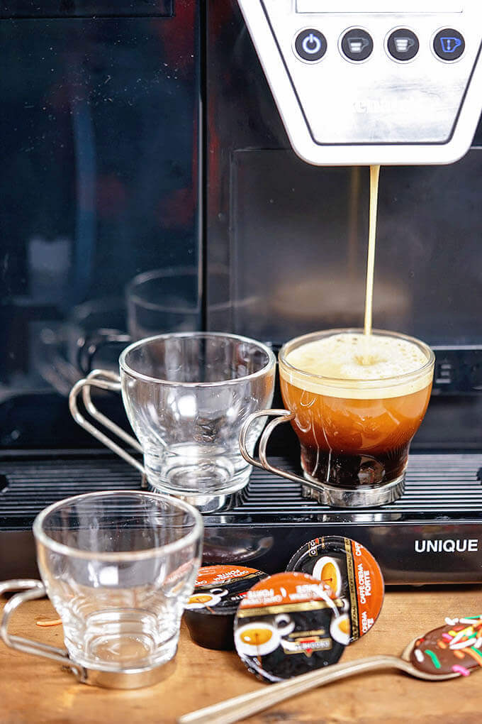 Coffee machine making espresso.