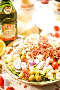 Steakhouse salad surrounded by the ingredients.