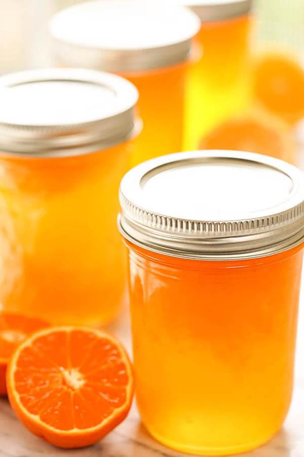 Jars of orange jelly with mandarins