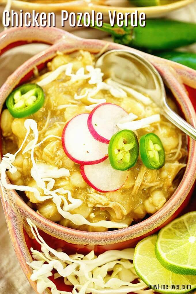 Chicken Pozole Verde topped with cabbage, radishes and sliced jalapeños